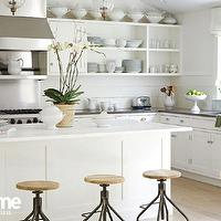 At Home in Fairfield County - kitchens - perimeter countertops, gray perimeter countertops, quartz perimeter countertops, gray quartz perimeter countertops, white kitchen island, marble kitchen island, marble island, swivel stools, swivel island stools, swivel kitchen island stools, white linen roman shade, linen roman shade, kitchen roman shades, cooktop backsplash, stainless steel cooktop backsplash, cooktop shelf, stainless steel cooktop shelf, open kitchen cabinets, white open kitchen cabinets, bridge kitchen faucet, cottage kitchen design,