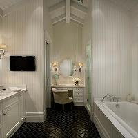Vallone Design - bathrooms - black and white bathroom, black tiled floor, glossy black floor, herringbone black tiled floor, drop-in bath, black herringbone tiles, black herringbone floor, black herringbone bathroom floor, black herringbone floor tiles, glossy black herringbone tiles, beadboard surround, black window casings, cafe curtains, cafe drapes, recessed panel cabinets, double vanity, polished nickel hardware, polished nickel faucet, beadboard wall treatment, beadboard in bathroom, vaulted ceiling, painted wood ceiling, white painted wood, black framed mirror, oval undermount sink, flat screen tv, tv in bathroom, make-up area, make-up vanity, velvet chair, flower shaped mirror, wall sconces, herringbone floor, black herringbone tile, Made Goods Fiona Mirror in Bone,