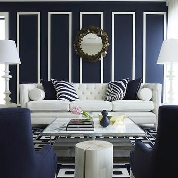 Greg Natale - living rooms - white and navy blue, navy blue living rooms, contemporary navy blue living rooms, white and blue living rooms, contemporary white and blue living rooms, navy blue paint color, navy blue walls, navy blue paint, white wall borders, white borders, rain drops mirrors, tufted sofas, high-back sofas, white tufted sofas, white high-back sofas, high-back tufted sofas, tufted high-back sofas, white tufted sofas, white high-back sofas, white tufted high-back sofas, zebra pillows, white and blue zebra pillows, navy blue pillows, geometric rugs, white and blue geometric rugs, navy blue living room chairs, navy blue chairs, white lacquer table, white lacquer accent table, floor lamps, living room floor lamps, white floor lamps, white living room floor lamps, contemporary floor lamps, contemporary solfas, contemporary white sofas, square cocktail tables, contemporary cocktail tables, navy blue room, navy blue room design, Jonathan Adler White Trousdale Lamp, Jonathan Adler C Jere Rain Drops Mirror,