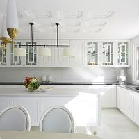 Greg Natale - kitchens - white kitchen, contemporary white kitchens, flat panel kitchen cabinets, white flat panel kitchen cabinets, glass-front upper cabinets, flat panel base cabinets, marble slab backsplash, marble island counters, marble island countertops, geometric ceiling, white geometric ceiling, black perimeter counters, black perimeter countertops, granite perimeter counters, black perimeter countertops, black granite perimeter counters, black granite perimeter countertops, oil-rubbed bronze island pendants, antique brass kitchen faucets, brass bridge kitchen  faucets,