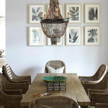 Interior Philosophy - dining rooms - coastal dining room, beachy dining room, driftwood colors, rustic wood dining table, rustic dining table, wicker dining chairs, rattan dining chairs, woven dining chairs, beaded chandelier, light blue walls, blue walls, teal art, framed art, framed botanicals,