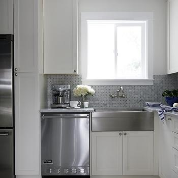House & Home - kitchens: shaker cabinets, white shaker cabinets, stainless steel apron sink, stainless steel apron front sink, wall mounted faucet, custom kitchen, white cabinets, white cabinetry, carrara marble countertops, basketweave tiled backsplash, marble in basketweave pattern, marble backsplash, carrara marble basketweave tile, restaurant style appliances, stainless steel dishwasher, stainless steel fridge, hexagonal floor tiled, mini hexagonal tiled floor, gray and white kitchen, white kitchen with marble countertops. apron front sink, stainless steel farmhouse style sink, wall-mount faucet, polished nickel wall-mount faucet, marble basketweave tile, marble basketweave backsplash, basketweave backsplash, basketweave tile backsplash,