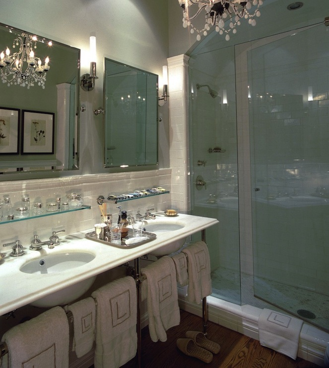 Jessica Lagrange Interiors - bathrooms - shower alcove, bathroom shower alcove, shower with barrel ceilings, barrel ceiling showers, seamless glass showers, subway tile shower, shower subway tiles, pale gray bathrooms, pale gray paint color, pale gray bathroom walls, pale gray bathroom paint, rectangular pivot mirrors, pivot mirrors, bathroom pivot mirrors, subway tile backsplash, bathroom subway tiles, glass shelves, bathroom glass shelves, monogrammed towels, monogrammed bath towels, 3-leg washstands, marble washstands, 3-leg marble washstands, oak wood floors, bathroom oak floors, oak floor in bathrooms, french chandeliers, french crystal chandeliers, double vanity ideas, double sink console,