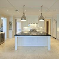 William Adams Design - kitchens - white cabinets, white kitchen cabinets, white recessed panel cabinets, chic white kitchen, limestone floors, limestone tiled floor, u-shaped kitchens, custom kitchen, marble countertops, slab marble backsplash, marble backsplash, solid marble backsplash, white beveled edge subway tile, white subway tile, subway tiled backsplash, mixing backsplash materials, stainless steel appliances, stainless steel microwave, stainless steel wine fridge, stainless steel dishwasher, stainless steel oven, oven focal wall, range focal walls, central island, kitchen island, undermount sink, kitchen island with black countertops, black countertops, polished nickel pendants, pendant lighting, pendant lighting over island, , Restoration Hardware Benson Pendant,
