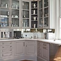Veranda - kitchens - Gwyneth Paltrow home, Gwyneth Paltrow kitchen, celebrity homes, celebrity kitchens, gray cabinetry, raised panel cabinetry, white countertops, marble backsplash, wine fridge, stainless steel wine fridge, wine column, brass hardware, stainless steel dishwasher, corner bar sink, bar sink, built-in coffee maker, built-in coffee machine, gray cabinets, gray kitchen cabinets, warm gray kitchens, gray kitchens, corner sinks, corner prep sinks, wine cooler, two temperature wine coolers, gray kitchen cabinets, gray kitchens, gray cabinets,
