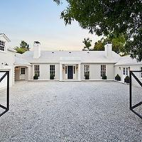 Veranda - home exteriors - iron gates, contemporary iron gates, gray gravel driveway, gravel driveway, white exteriors, tiled roof, gray tiled roof, double garage doors, topiaries, u-shaped home exterior, u-shaped home layout, Gwyneth Paltrow home, his and her garage, his and her garages, his and her garage doors,
