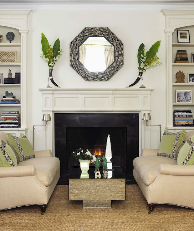 Anne Hepfer Designs - living rooms - fireplace seating, horn vases, black horn vases, octagon mirrors, black octagon mirrors, octagonal mirrors, black octagonal mirrors, fireplace mirrors, octagon fireplace mirrors, octagonal fireplace mirrors, traditional fireplaces, fireplace built-ins, built-ins flanking fireplace, living room built-ins, living room built-in cabinets, living room cabinets, living room bookcases, built-in bookcases, millwork, built-ins millwork, fireplace millwork, arched built-ins, arched built-in cabinets, art deco cocktail tables, mirrored cocktail tables, sofas facing each other, two sofas facing each other, loveseats, loveseats facing each other, rolled-arm sofas, tan sofas, tan rolled-arm sofas, sofas with caster legs, caster leg sofas, green velvet pillows, green velvet, greek key, greek key trim, white and black greek key trim, green greek key pillows, greek key pillows, swing-arm floor lamps, bookcase vignettes,