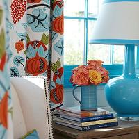 Tracery Interiors - bedrooms - turquoise blue and orange, turquoise and orange, turquoise blue and orange design, turquoise and orange design, turquoise blue and orange bedrooms, turquoise blue and orange bedrooms, painted window moldings, window moldings, turquoise blue window moldings, glossy window moldings, turquoise blue ceramic lamps, patterned drapes, floral drapes, turquoise blue and orange drapes, ivory wingback chairs, wingback chairs, bedroom chairs, nailhead chairs, nailhead wingback chairs, turquoise blue pillows, turquoise lamp, turquoise table lamp, turquoise blue lamp, blue and orange curtains, blue and orange drapes,