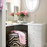 Laura Stein Interiors - closets - dressing rooms, chic dressing rooms, L shaped vanity, dressing room vanity, dressing room vanities, frameless vanity mirror, vanity mirrors, round ottomans, zebra ottomans, nailhead ottomans, vanity ottomans, round vanity ottomans, zebra vanity ottomans, vanity stools, round vanity stools, zebra vanity stools, round zebra ottomans, round zebra stools, tan dressing rooms, tan walls, tan paint, porthole windows, porthole shaped windows, windows shaped like portholes, zebra ottoman, round zebra ottoman, nailhead zebra ottoman, studded zebra ottoman,