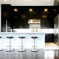 Marie Flanigan Interiors - kitchens - minimalist kitchen, contemporary kitchen, black and white kitchen, black and white modern kitchen, black cabinets, black kitchen cabinetry, white countertops, white backsplash, waterfall edge peninsula, peninsula island, breakfast bar island, modern chrome barstools, backless barstools, glossy hardwood floors, dark hardwood floors, tiled floor, light tiled floor, stainless steel fridge, polished nickel hardware, modern faucet, stainless steel oven, stainless steel hood, stainless steel oven backsplash, stainless steel range backsplash, chic kitchen, black kitchen cabinets, black and white kitchen,