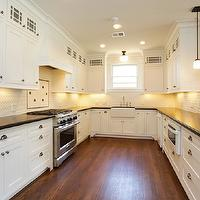Marie Flanigan Interiors - kitchens - black and white kitchen, shaker cabinets, shaker style cabinets, craftsman kitchen, craftsman style kitchen, hardwood floors, black countertops, apron sink, farmhouse sink, brushed nickel hardware, mini brick backsplash, white mini brick backsplash, stainless steel range, microwave built in to cabinetry, breakfast bar, peninsula island, window over sink, square mini pendants. mini pendants, schoolhouse pendant, recessed lighting, pot lights, under cabinet lighting,