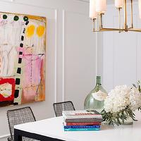 Marie Flanigan Interiors - dining rooms - white walls, abstract art, brightly colored abstract art, metal based parsons dining table, parsons style dining table, wire chairs, modern wire chairs, antique brass chandelier, demi john, stacked books, flowers, contemporary dining room, modern dining room,