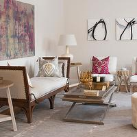 Marie Flanigan Interiors - living rooms - feminine living room, pretty living room, pink and purple abstract, abstract art over daybed, chaise, linen covered daybed, linen chaise, gray ikay pillows, gray tray coffee table, distressed white end table, ivory ceramic lamps, black and white abstract art, white walls, ivory walls, gray rug, soft gray rug, ivory tufted stools, ivory button tufted stools, brass candleholder, white tufted chairs, animal legged table, pink damask pillows, girly living room,