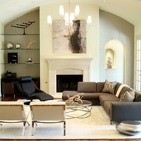 Marie Flanigan Interiors - living rooms - barrel ceiling, ivory walls, cream walls, French doors, medium hardwood floors, ivory area rug, cream area rug, glass column floor lamp, glass floor lamp, chrome side chairs, chrome based chairs, chrome and leather accent chairs, gray sectional sofa, contemporary sectional sofa, gray sectional with button tufting, black leather lounge chair, black lounge chair, metal and glass coffee table, round glass coffee table, contemporary coffee table, fireplace, fireplace alcove, fireplace alcove with glass shelving, abstract art, abstract art over fireplace, curved ceiling, flat screen tv, wall mounted flat screen tv, sectional, sectional sofa, gray sectional, gray sectional sofa, tufted sectional, tufted sectional sofa, gray tufted sectional, gray tufted sectional sofa,