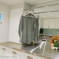 Rambling Renovators - laundry/mud rooms - chic laundry room, stylish laundry room, ikea akurum cabinets, stat door fronts, white cabinetry, modern white cabinets, brushed nickel hardware, modern cabinet hardware, seafoam green tile, glass tile backsplash, green glass backsplash tile, drying rail, stainless steel countertops, mirrored wall, mirrored backsplash, laundry rods, ikea doors, ikea stat, ikea stat doors, Ikea Akurum, Ikea Stat,