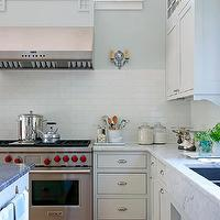BHG - kitchens - soapstone island, soapstone countertops, white cabinets, white kitchen, undermount sink, prep sink in kitchen island, prep sink, undermount prep sink, Shaker cabinets, white Shaker cabinets, carrara marble, carrara marble countertops, brushed nickel hardware, carrara marble apron front sink, apron front sink, carrara marble sink, solid marble sink, white subway tiled backsplash, subway tiled backsplash, subway tile, white subway tile, vintage style faucet, corbel detail, candleabra style wall sconces, candleabra sconces, wolf range, stainless steel range, subway tile backsplash, white subway tile, subway tile kitchen, white subway tile backsplash, white subway tile kitchen, white kitchen with subway tile backsplash,