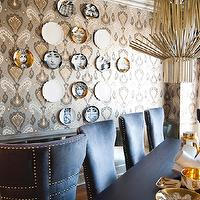 Smith Boyd Interiors - dining rooms: F. Schumacher - Ikat wallpaper, ikat wallpaper, gold and silver ikat wallpaper, gray dining chairs, black dining table, gray upholstered chairs with nailhead trim, gold and white bowls, gold chandelier, gold pendant, Fornasetti Plate, glamorous dining room, gold and silver dining room,