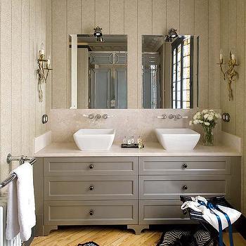Soledad Suarez - bathrooms - herringbone floors, bathroom herringbone, herringbone bathroom floors, wood herringbone floors, herringbone wood floors, zebra rugs, zebra cowhide rugs, bathroom stools, folding stools, bathroom folding stools, black folding stools, gray bathroom cabinets, double bathroom vanity, gray double bathroom vanity, white vessel sinks, bathroom vessel sinks, his and her sinks, wall-mount faucets, wall-mounted bathroom faucets, frameless bathroom mirror, silver branch sconces, gray tongue and groove, bathroom tongue and groove, gray bathroom vanity, gray bathroom cabinets,