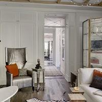 Veranda - bathrooms - dressing rooms, celebrity dressing rooms, bathroom dressing rooms, floor to ceiling cabinets, floor to ceiling closet cabinets, mirrored closet doors, freestanding tubs, wall-mount tub fillers, zebra cowhide rugs, rustic wood floors, wood bathroom floors, wood dressing room floors, white sofas, bathroom sofas, dressing room sofas, geometric accent tables, geometric wood tables, mirrored floor screens, mirrored folding screens, dressing room screens, mirrored accent tables, dressing room tables,