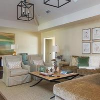 EJ Interiors - living rooms - gold, living room, green, pillows, rug, table, lamps, chandelier, coffee table, wall art, brown and green living room,