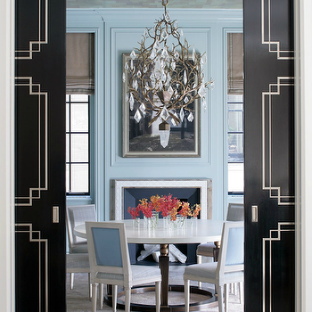 Peter Pennoyer Architects - dining rooms - blue and black dining rooms, blue dining rooms, blue paint colors, dining room paint colors, blue dining room walls, blue dining room paint color, blue crown moldings, gray roman shades, dining room roman shades, modern fireplaces, art over fireplace, art abobe fireplace, fireplace art, crystal chandeliers, dining room chandeliers, dining tables, round dining tables, blue dining chairs, french dining chairs, square back dining chairs, blue french dining chairs, blue square back dining chairs, black pocket doors, dining room pocket doors, pocket doors in dining rooms, black and white pocket doors,