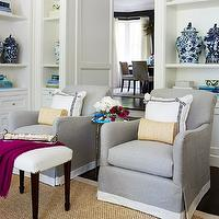 McGill Design Group - living rooms - chinese ming jars, turquoise accents, built-in vignette, bookcase vignette, bound sisal rugs, gray accent chairs, gray chairs, chairs with banding, banded chairs, gray linen chairs, white and blue pillows, accent tables, round accent tables, faux bamboo tables, brass accent tables, brass faux bamboo tables, round faux bamboo tables, mirrored top tables, mirror top tables, white ottomans, living room ottomans, fuchsia throws, hardwood floors,