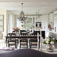 Martha O&#039;Hara Interiors - dining rooms - Benjamin Moore - Pale Moon - iron chandeliers, dining room chandeliers, black and brown dining tables, dining table with cabriolet legs, cabriolet legs, black dining chairs, captain chairs, oval back dining chairs, oval back chairs, L shaped kitchens, white kitchen cabinets, marble countertops, white plank ceilings, corner pantry, corner pantry cabinets, pantry cabinets, white pantry cabinets, white wood kitchen hoods, wood kitchen hoods, double door refrigerators, wood refrigerators, butter yellow paint colors, dining room paint colors, butter yellow walls, yellow dining rooms,