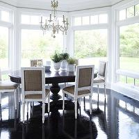 Martha O'Hara Interiors - dining rooms - chic dining rooms, floor to ceiling windows, dining room windows, glossy wood floors, glossy hardwood floors, espresso hardwood floors, pedestal dining tables, dining tables, extension dining tables, square back chairs, french chairs, white french chairs, white square back chairs, beaded chandeliers, dining room chandeliers, bay window, dining room bay window,
