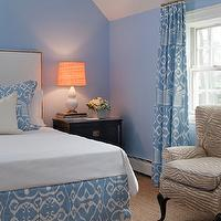 Tiffany Eastman Interiors - bedrooms - tropical bedrooms, blue bedrooms, vaulted ceilings, bedroom with vaulted ceilings, vaulted ceiling bedrooms, blue bedroom walls, white leather headboards, leather headboards, nailhead headboards, leather headboard with nailhead trim, quadrille fabrics, china seas, quadrille china seas, island ikat, island ikat shams, island ikat bed skirts, island ikat drapes, island ikat curtains, island ikat zibby blue, black nightstands, white ceramic lamps, double gourd lamps, white double gourd lamps, vintage chairs, wingback chairs, vintage wingback chairs, white and brown zebra, brown zebra chairs, sisal carpeting, ikat curtains, ikat drapes, ikat window panels, ikat window treatments, blue ikat curtains, blue ikat drapes, blue ikat window panels, blue ikat window treatments, blue curtains, blue drapes, blue window panels, blue window treatments, China Seas Island Ikat Zibby Blue on White,