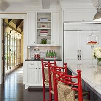 Martha O'Hara Interiors - kitchens - Benjamin Moore - Shelburne Buff - two-tone kitchens, white perimeter cabinets, black perimeter countertops, black granite countertops, black granite perimeter countertops, subway tile backsplash, open shelving, kitchen open shelving, kitchen bookcase, wood refrigerators, white wood refrigerators, wood panel refrigerators, golden wheat paint colors, golden wheat walls, golden wheat paint colors, red counter stools, seagrass counter stools, red seagrass stools, charcoal gray kitchen islands, granite countertops, beveled granite countertops, granite island countertops, kitchen island sinks, brushed nickel faucets, yoke pendants, island yoke pendants, white wood beams, seagrass barstools, seagrass counter stools, red seagrass bar stools, red seagrass barstools, red seagrass counter stools,