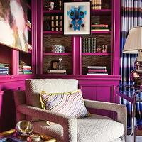 Atlanta Homes & Lifestyles - dens/libraries/offices - Benjamin Moore - Mulberry - jewel tone room, jewel tones, plum color, glossy plum color, glossy plum-pink color, glossy cabinetry, high gloss cabinetry, library, art in front of bookcases, wallpaper lining shelves, wallpaper backing bookshelves, styled bookcases, styled shelves, plum pink, plum, modern library, abstract art, framed abstract art, stacked books, bookcases, bookshelves, silver lamp, brass table, brass accent table, brass and glass accent table, chrome table, chrome and glass table, vintage chairs, vintage chair, Milo Baughman chair, office, home office, den, library, home library,