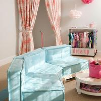 Super cute girly pink and blue playroom with sisal carpet and soft blue walls. A fabric ...