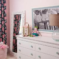 Liz Carroll Interiors - girl's rooms - Benjamin Moore - Touch of Pink - white dresser, dresser, girls dresser, aqua blue knobs, aqua blue hardware, ballerina print, black and white ballerina print, black and white art print, monogrammed toy basket, pink toy basket, pink storage basket, pink storage bin, baby pink walls, soft pink walls, light pink walls, pink walls, black gray and pink drapes, modern floral curtains, modern floral drapes, white carved wood floor mirror, leaning floor mirror, floor mirror, toy basket, pink toy basket, toys, bears, doll, canvas, bag, glass table lamp, aqua blue table lamp, burlap drum shade, , pink and blue floral drapes, girls drapes, girls curtains, floral curtains, modern floral curtains,
