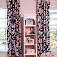Liz Carroll Interiors - girl's rooms - Benjamin Moore - Touch of Pink - soft pink walls, baby pink walls, pale pink walls, light pink walls, white wood blinds, white blinds, pair of windows, pink black and gray floral fabric, contemporary floral fabric, tall bookcase, coral pink backed bookcase, stacked books, framed photography, ivory jewelry box, pink monogrammed storage basket, pink storage basket, pink basket, toys, striped ceiling, striped pink and white ceiling, pink and white ceiling, striped ceiling, striped painted ceiling, Caitlin Wilson Textiles, Navy Fleur Chinoise Fabric, Navy Fleur Chinoise Fabric drapes, pink and navy blue floral curtains, pink and navy blue drapes,