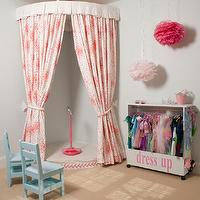Cute dress up area and stage in girly playroom. The corner stage was created by a raised ...