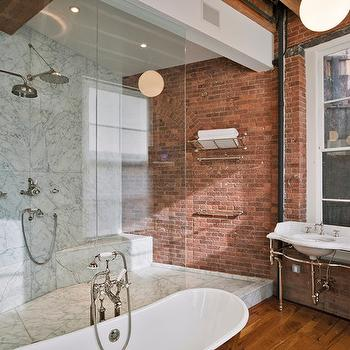 Jane Kim Design - bathrooms - expossed brick wall, red brick wall, brick wall, urban bathroom, loft bathroom, large window, washstand in front of window, chrome based washstand, double sink washstand, his and her sinks, marble top washstand, walk-in shower, glass shower partition, wood beam, rustic wood beam, recessed lighting, recessed lighting in shower, lighting inside shower enclosure, shower recessed lighting, exposed brick wall in shower, shower exposed brick walls, glass shower, glass shower enclosure, cast iron bath tub, freestanding cast iron bath tub, oval cast iron bath, floor mounted faucet, rainfall showerhead, marble tiled shower, marble tiled shower enclosure, marble tile, marble tile shower, marble tiled walk-in shower, shower seat, towel rack, vintage style towel rack, polished nickel bathtub, mercer bathtub, hardwood floors, wood floors in bathroom, marble shower surround, marble tile shower, marble shower floor, marble tile shower floor, marble shower bench, corner shower bench, shower design, master bath shower design, modern shower design, Urban Archaeology Washstand, Urban Archaeology Mercer Bathtub,