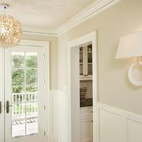 Lou Lou's Decor - entrances/foyers - white wainscotting, wainscotting, latte wall color, latte walls, french doors, french doors leading to deck, crown molding, capiz shell flower pendant, capiz shell flower chandelier, ring wall sconce, ring sconce, Viva Terra Lotus Flower Chandelier, Visual Comfort Chart House Large Ring Wall Sconce in Alabaster with Natural Paper Shade, lotus flower chandelier, alabaster sconce, alabaster rung wall sconce, lotus flower chandelier, lotus chandelier, Chart House Large Ring Wall Sconce, Viva Terra Lotus Flower Chandelier,