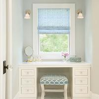 Lou Lou's Decor - bathrooms - soft gray green walls, gray green wall color, powdery gray green wall color, spa-like bath, built-in make up vanity, custom vanity, make-up vanity, make-up area in bathroom, white floor tiles, crystal hardware, white vanity, x-bench, window nook, blue and ivory geometric stool, white countertop, perfume, make-up mirror, adjustable make-up mirror, sconces flanking window, brushed nickel wall sconces, roman blind, blue roman blind, pink flowers, built-in cabinets, built-in vanity, gray walls,