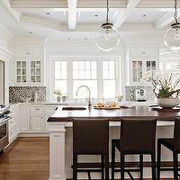 New England Home - kitchens - traditional kitchen, white kitchen, white kitchen cabinet, hardwood floors, white cabinetry, millwork, coffered ceiling, coffered ceiling in kitchen, recessed lighting, pot lights, stained wood countertop, stained butcher block, stained butcher block countertop, kitchen island, leather barstools, stainless steel oven, prep sink, gooseneck faucet, glass fronted cabinetry, ceiling height cabinetry, marble countertops, mosaic backsplash, orchids, spherical glass pendants, glass pendants, leather barstools, contemporary barstools, mosaic glass backsplash, mosaic kitchen backsplash, mosaic glass kitchen backsplash, mosaic tile backsplash, glass tile backsplash, glass tile backsplash with white cabinets,
