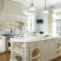 Kitchens by Deane - kitchens - kitchen hood corbels, gray kitchen hood, stone kitchen hood, blue and yellow kitchen, yellow and blue kitchen, cream and blue kitchen, blue and cream kitchen, blue walls, blue paint, blue kitchen walls, french doors, kitchen french doors, yellow and blue curtains, blue and yellow curtains, yellow and blue drapes, blue and yellow drapes, geometric curtains, geometric drapes, cream kitchen cabinets, shaker kitchen cabinets, cream cabinets, calcutta gold marble, calcutta gold marble countertops, cream kitchen island, beveled marble countertops, carved legs, kitchen island with carved legs, lit shelving, kitchen island lighting, blue walls, blue kitchen walls, , Restoration Hardware Keynes Prism Single Pendant,