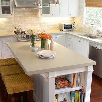 Brittany Stiles - kitchens: white kitchen island, kitchen island, beadboard island, beadboard kitchen island, island bookcase, kitchen island bookcase, kitchen island corbels, island corbels, gray quartz countertops, backless counter stools, backless seagrass counter stools, shaker kitchen cabinets, beveled marble tiles, beveled marble subway tiles, beveled marble subway tile backsplash, beveled marble kitchen tiles, stainless steel kitchen hood, cabinets over kitchen hood, cabinets above kitchen hood, sink next to dishwasher, dishwasher next to sink, industrial island pendants, benson pendants, kitchen island pendants, cherry wood floors, seagrass barstools, seagrass counter stools,