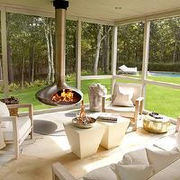 Paul Davis New York - decks/patios: white painted floor, white floor, white painted wood floor, painted wood floor, ivory moroccan pouf, gold moroccan pouf, pearlescent ivory moroccan pouf, metallic gold pouf, modern patio furniture, ivory throw, modern ivory stools, gold pouf, outdoor armchair, outdoor sofa, patio furniture, limed oak, ceiling mounted fireplace, fireorb, outdoor fireorb, covered patio, screen in patio, patio, outdoor furniture, white seat cushions, screened porch, screened porch with fireplace,