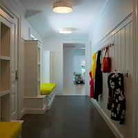Alisberg Parker Architects - laundry/mud rooms - mudroom design, mud room design, long mudroom, board and batten, mudroom board and batten, mudroom hooks, mudroom bench, mudroom cubbies, mudroom built-ins, built-in bench, mudroom bench, neon yellow, neon yellow cushion,