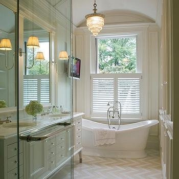 Kate Coughlin Interiors - bathrooms - master bathroom, long master bathroom, barrel ceiling, bathroom with barrel ceiling, barrel ceiling bathroom, barrel ceiling in bathroom, freestanding tub, floor mount tub, plantation shutters, plantation shutters in bathroom, bathroom plantation shutters, crystal chandelier, bathroom chandeliers, crystal chandeliers in bathroom, herringbone floor, herringbone tiles, herringbone tile floor, herringbone tile bathroom, herringbone tile bathroom floor, chevron floor, chevron tiles, chevron tile floor, chevron tile bathroom, chevron tile bathroom floor, double bathroom vanity, white bathroom cabinets, white bathroom vanity, his and her sinks, bathroom tv, tv in bathroom, floor to ceiling bathroom cabinets, built-in bathroom cabinets, floor to ceiling built in bathroom cabinets, crystal knobs, crystal hardware,