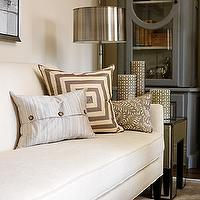 House &amp; Home - living rooms - Cloverdale Paint - Golden Pastel - gary cabinets, glass front cabinets, cabinets with glass doors, contemporary sofas, contemporary white sofa, white sofa, mitered pillo, gray mitered pillows, cream and gray pillows, gray patterned pillow, mirrored end table, mirrored accent table, iron caged candles, iron hurricanes, polished nickel lamp, polished nickel tabel lamp,
