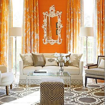 Mary McDonald - living rooms - orange and gray design, orange and gray room, gray and orange design, orange and gray living room, gray and orange living room, orange walls, orange curtains, orange drapes, rococo mirror, white rococo mirror, white sofa, gray greek key pillows, greek key pillows, cream and gray rug, geometric rug, cream and gray geometric rug, gray geometric rug, cube ottoman, geometric ottoman, gray cube ottoman, gray geometric ottoman, gray ottoman, geometric ottoman,