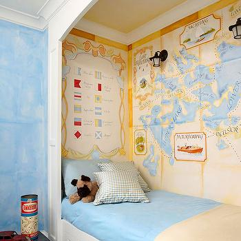 BHG - boy's rooms - pirate bedroom, nautical bedroom, pirate themed boys bedroom, nautical themed boys bedroom, pirate themed bedroom, painted mural, pirate mural, hand painted mural, blue walls, sky blue walls, blue bedding, blue bed linens, sand colored throw, plaid carpet, blue plaid carpet, bed nook, framed bed nook, under bed storage, storage drawers under bed, treasure map mural, pirates map mural, symbol flag mural, compass ceiling, world map wallpaper, world map wallpaper, vintage map wallpaper,