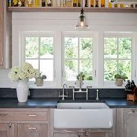 Shelter Interiors LLC - kitchens - rustic kitchen, rustic kitchen cabinets, country kitchen cabinets, wire brushed oak cabinets, wire brushed oak kitchen cabinets, soapstone countertops, wood paneling, white wood paneling, wood panel backsplash, white wood backsplash, farmhouse sink, bell jar pendant, glass bell jar pendant, pendant over sink, pendant over kitchen sink, pendant abobe sink, pendant above kitchen sink, brushed nickel faucet, bridge kitchen faucet, rustic wood beams, kitchen shelf, shelf over kitchen sink, shelf above kitchen sink, collection of olive oils, display shelf, kitchen display shelf,