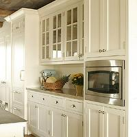 Shelter Interiors LLC - kitchens - plank ceiling, rustic plank ceiling, wood beams, rustic wood beams, kitchen plank ceiling, rustic plank kitchen ceiling, rustic kitchen beams, glass front cabinets, glass front kitchen cabinets, built in microwave, microwave nook, pantry cabinets, cream pantry cabinets, rustic plank floors, plank floors, kitchen plank floors, cream cabinets, cream kitchen cabinets, gold countertops, stone countertops, gold stone countertops, cream paneling, sisal runner, kitchen runner, sisal kitchen runner, cream wall panels, cream wall paneling, kitchen panels, kitchen wall paneling,
