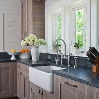Shelter Interiors LLC - kitchens - rustic kitchen, rustic kitchen cabinets, country kitchen cabinets, wire brushed oak cabinets, wire brushed oak kitchen cabinets, soapstone countertops, wood paneling, white wood paneling, wood panel backsplash, white wood backsplash, farmhouse sink, bell jar pendant, glass bell jar pendant, pendant over sink, pendant over kitchen sink, pendant abobe sink, pendant above kitchen sink, brushed nickel faucet, bridge kitchen faucet, rustic wood beams, kitchen shelf, shelf over kitchen sink, shelf above kitchen sink, collection of olive oils, display shelf, kitchen display shelf, rustic crown molding, rustic molding,